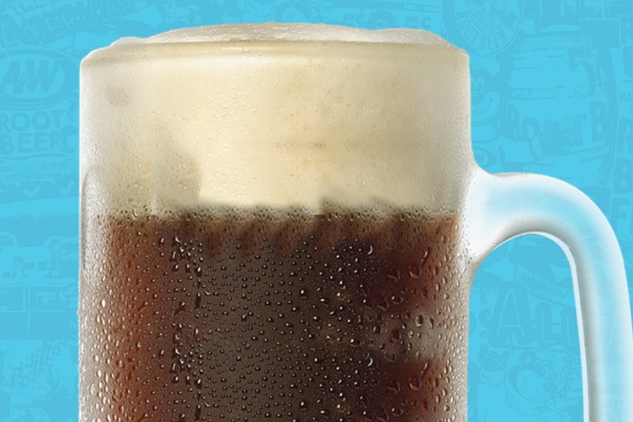 Blank mug filled with A&W Root Beer on blue background.