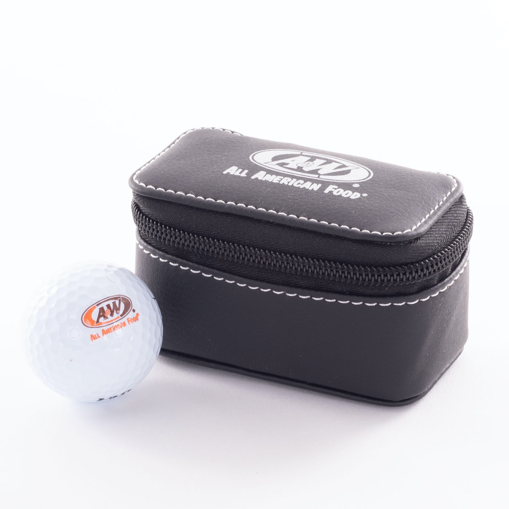 White golf ball imprinted with the A&W Restaurants logo is on the left side of the image. A black golf travel case is on the right side imprinted with the A&W Restaurants logo in white.