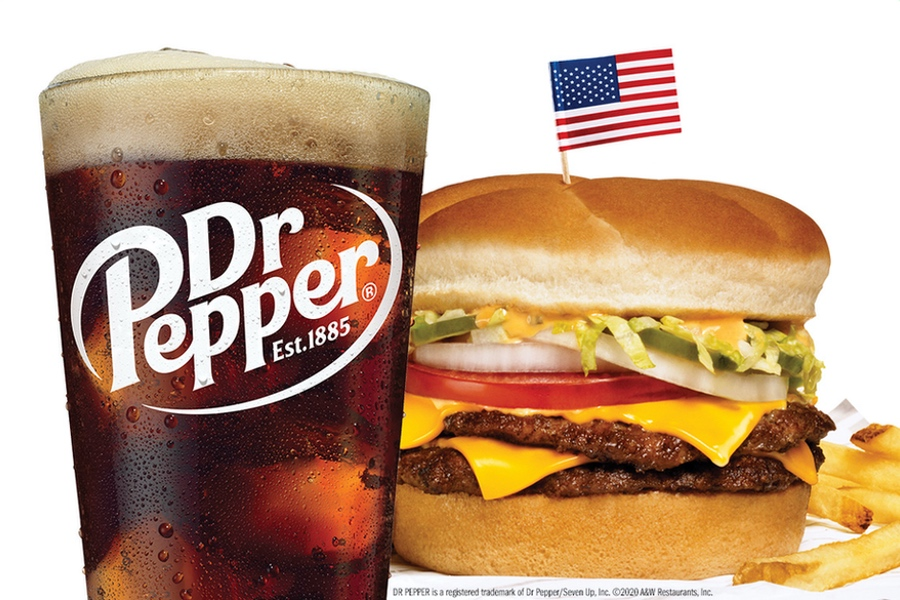 Image of glass of Dr Pepper on left side. Next to the glass is an A&W Papa Burger and fries.