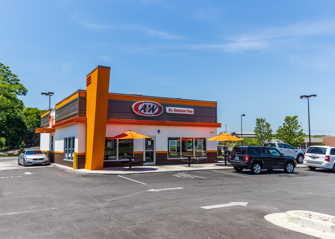 A&W Restaurant Exterior in Richmond, Kentucky. Cars are wrapped around drive-thru