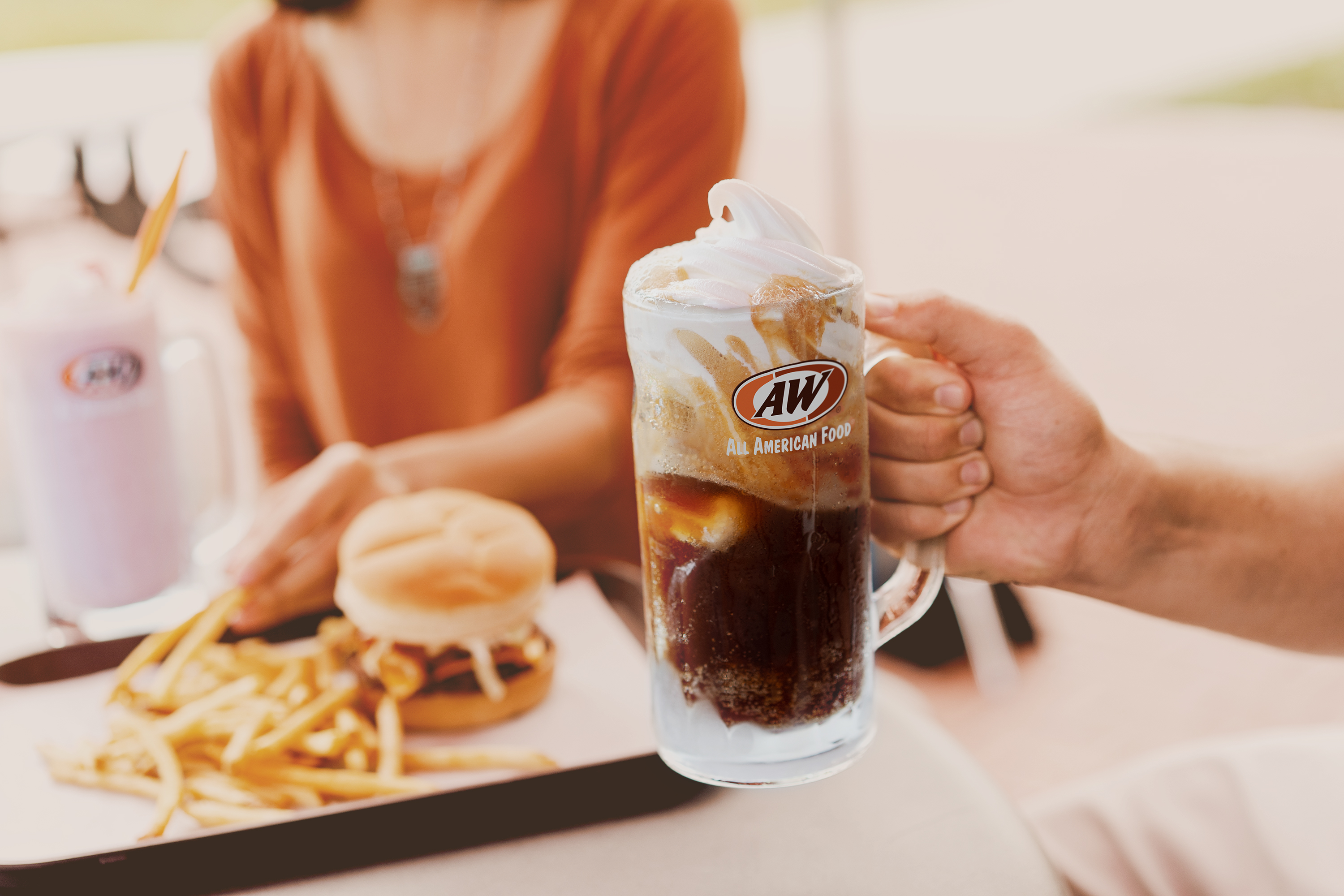 Holding Root Beer Float with A&W logo minus ampersand