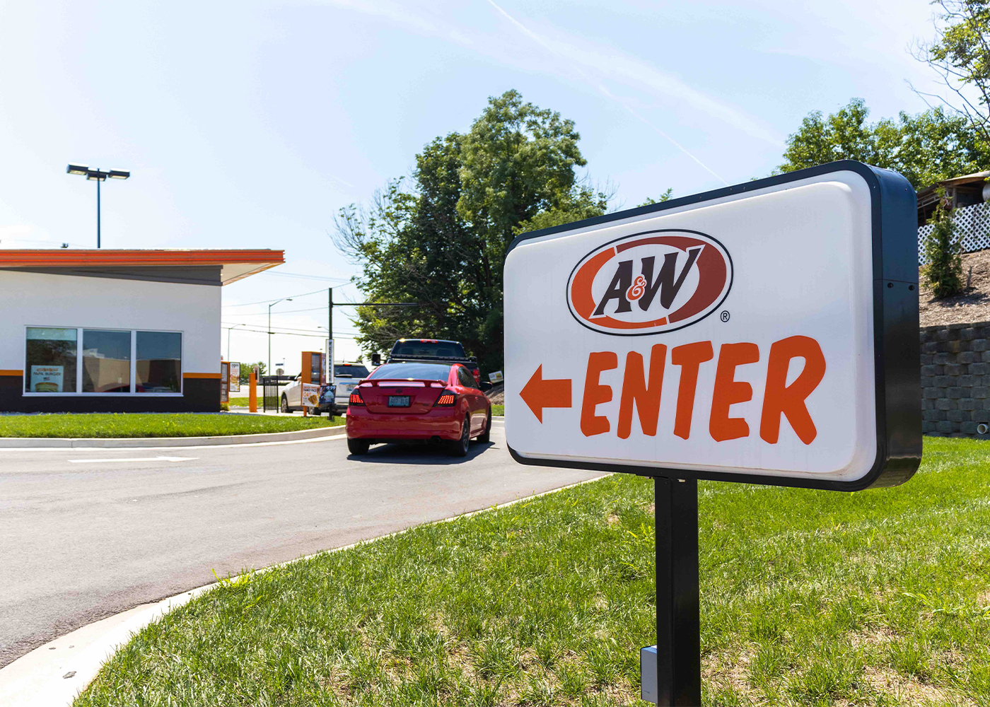 Exterior photo of A&W Restaurant drive-thru sign during the daytime in Richmond, KY.