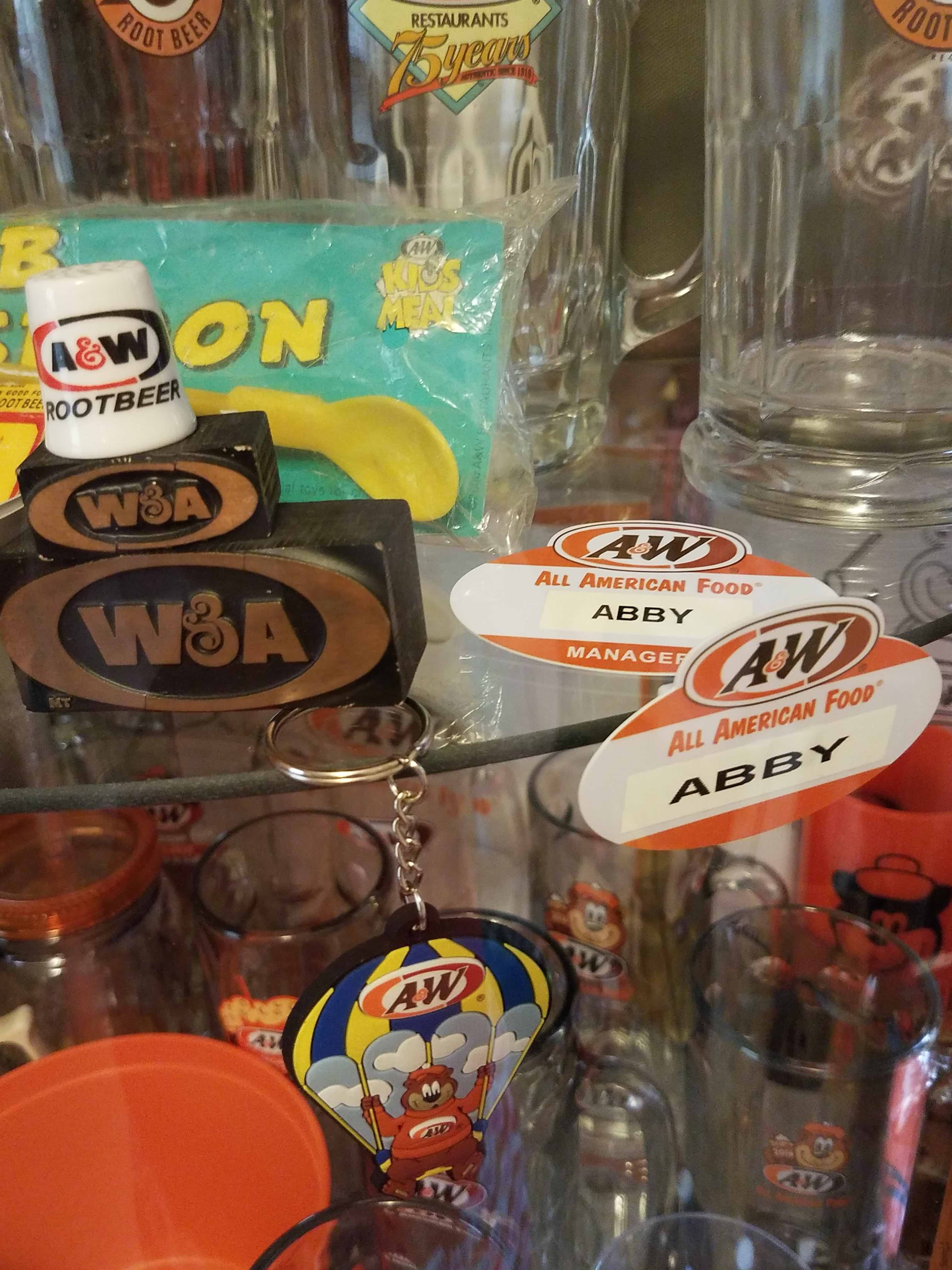 Various vintage A&W Restaurants memorabilia on a shelf