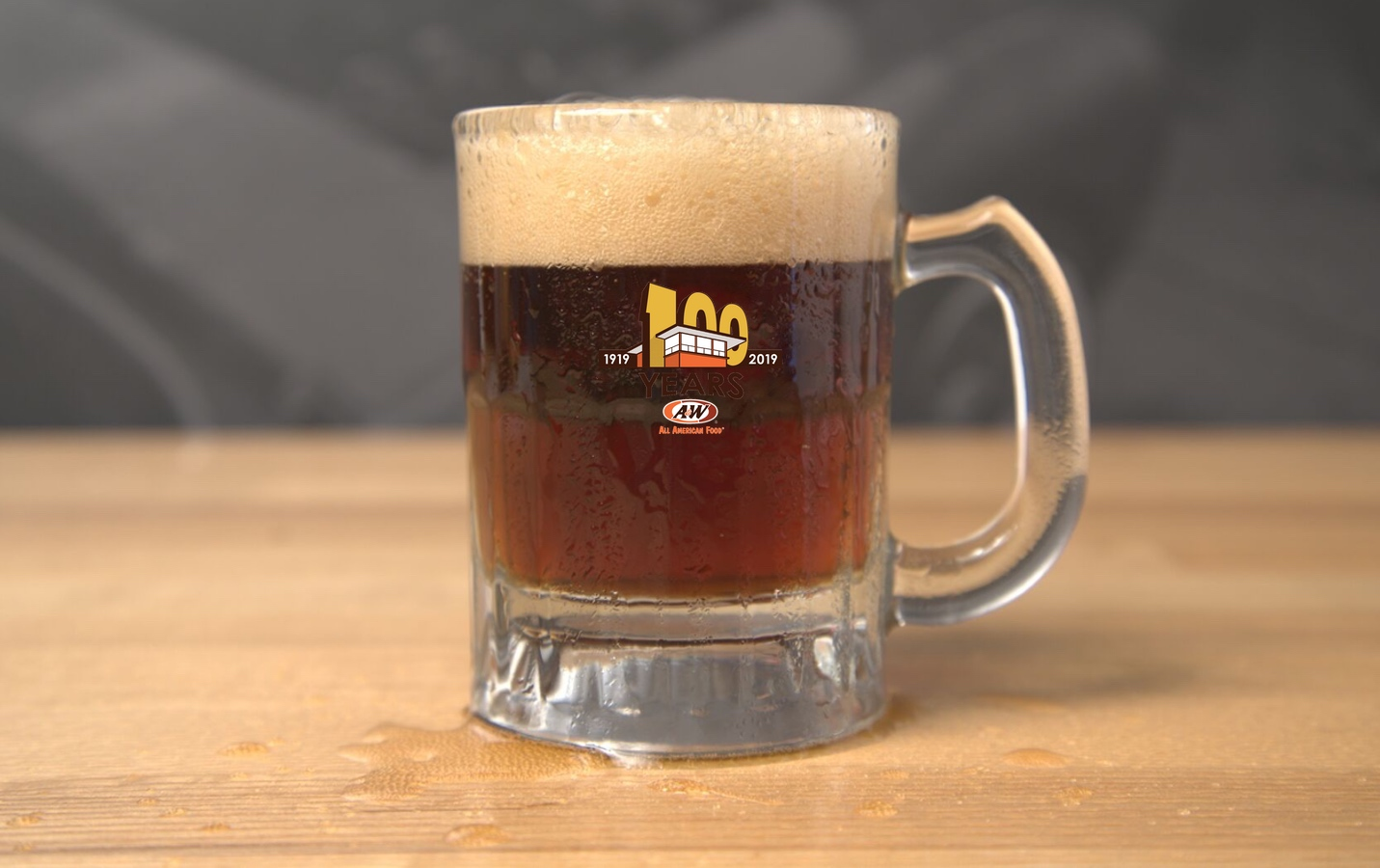 A&W Baby Mug with gold 100th Anniversary logo filled with root beer