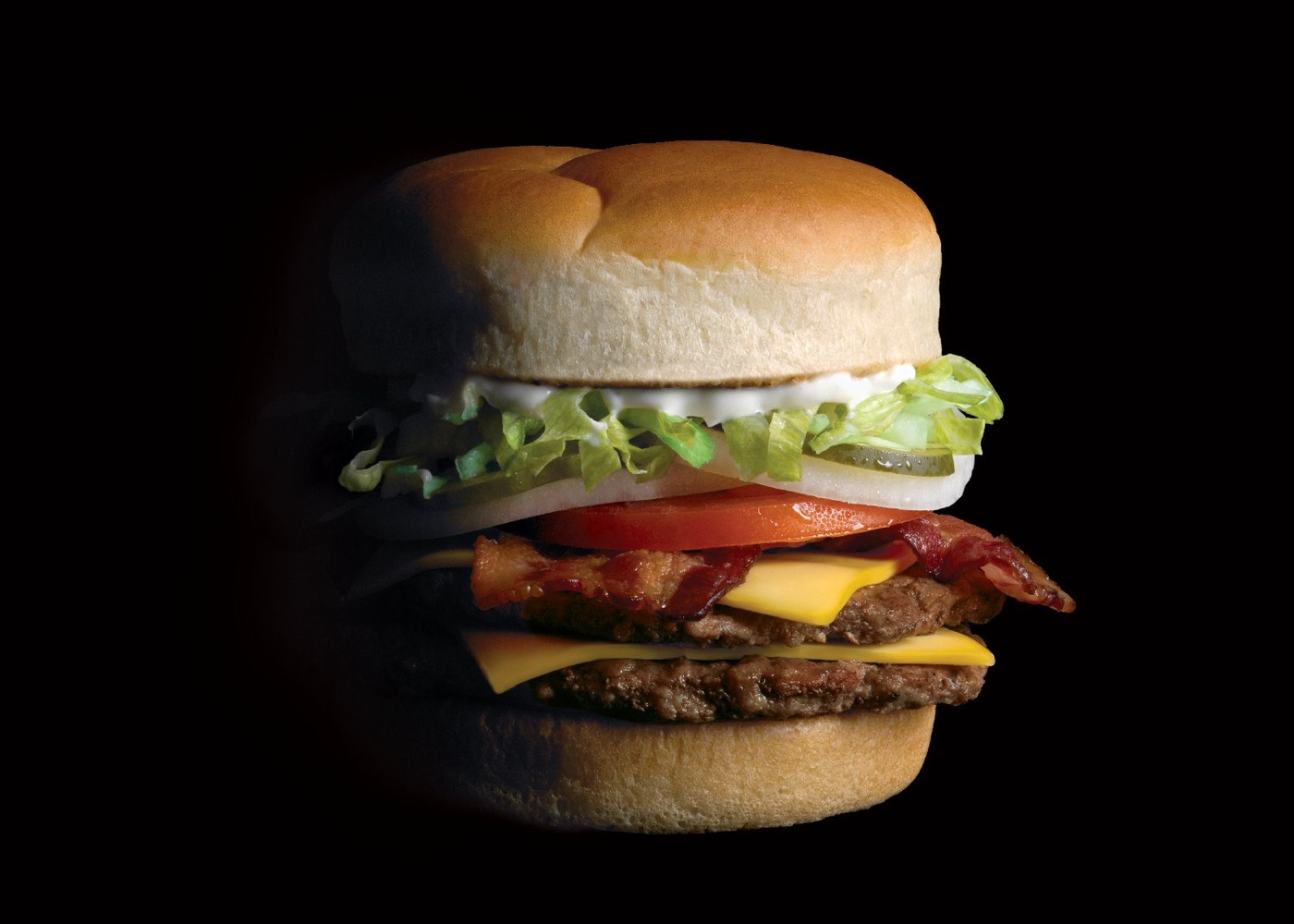 Bacon Double Cheeseburger with lettuce, onion, tomato, pickles, American cheese, and mayonnaise