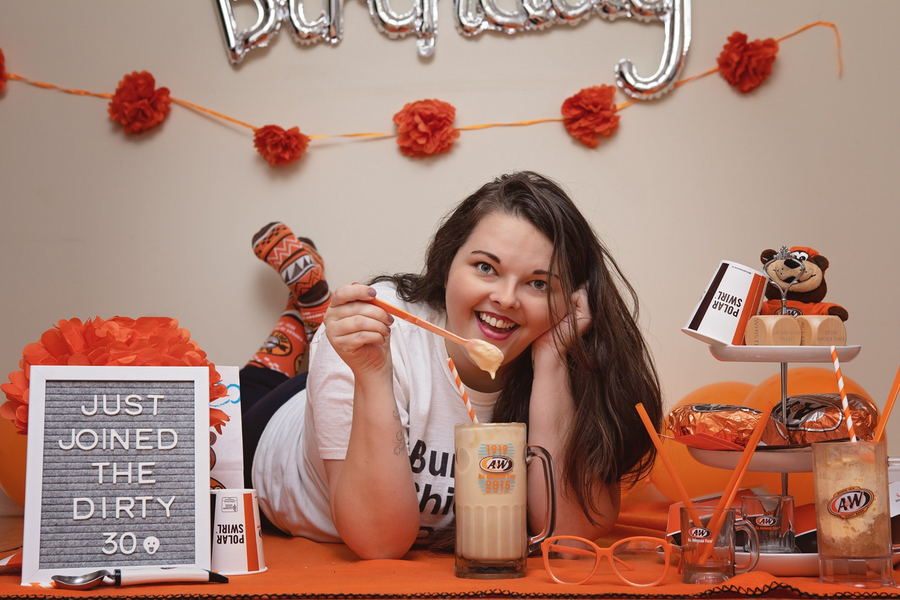 Briana with root beer float in A&W Restaurants mug