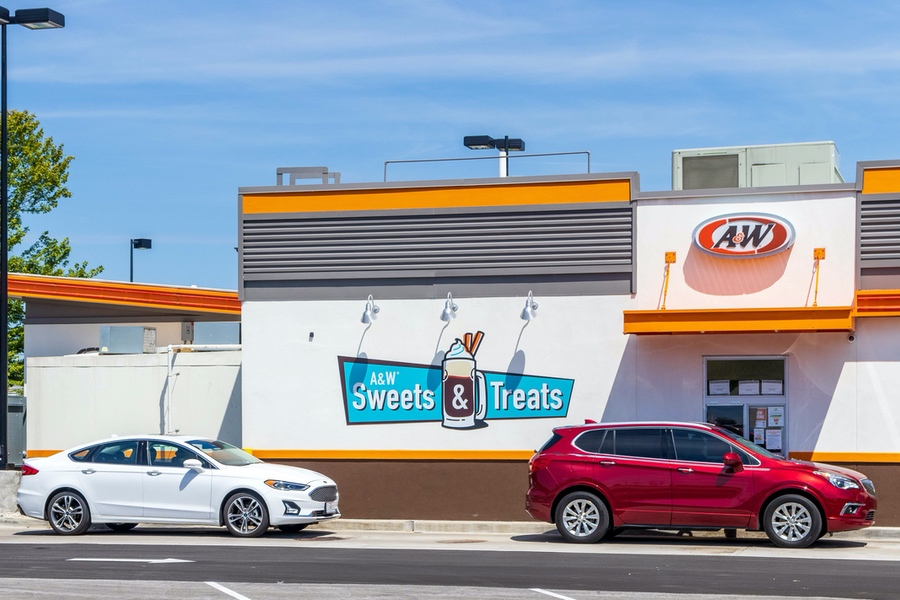 Photo of two cars in an A&W Restaurant drive-thru