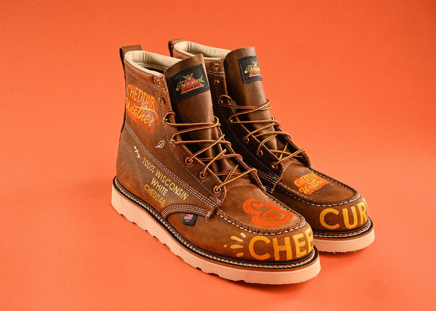 Cheddar Weather Boots on orange background.