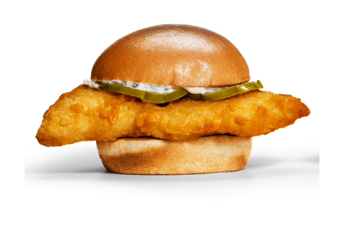 Golden-fried cod filet on a potato bun with tartar sauce and dill pickles.