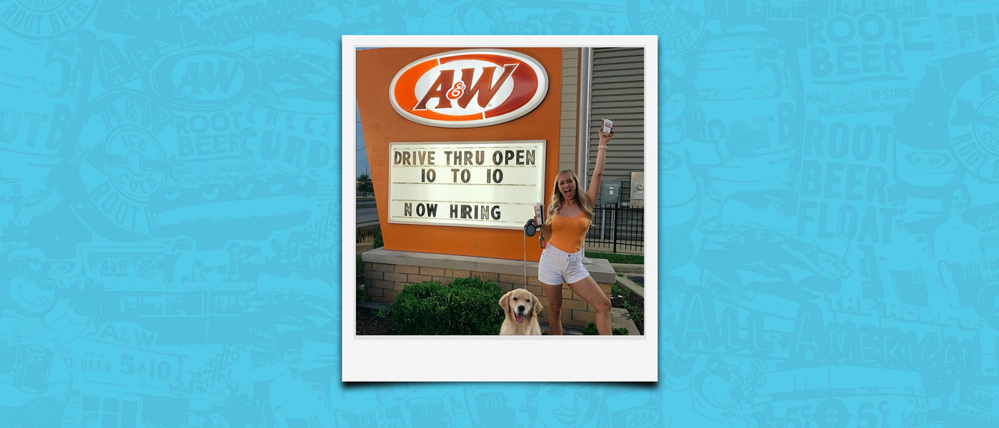 Background is blue. Polaroid of Tara Rushmer in front of A&W Restaurant holding a box of Cheese Curds in the air
