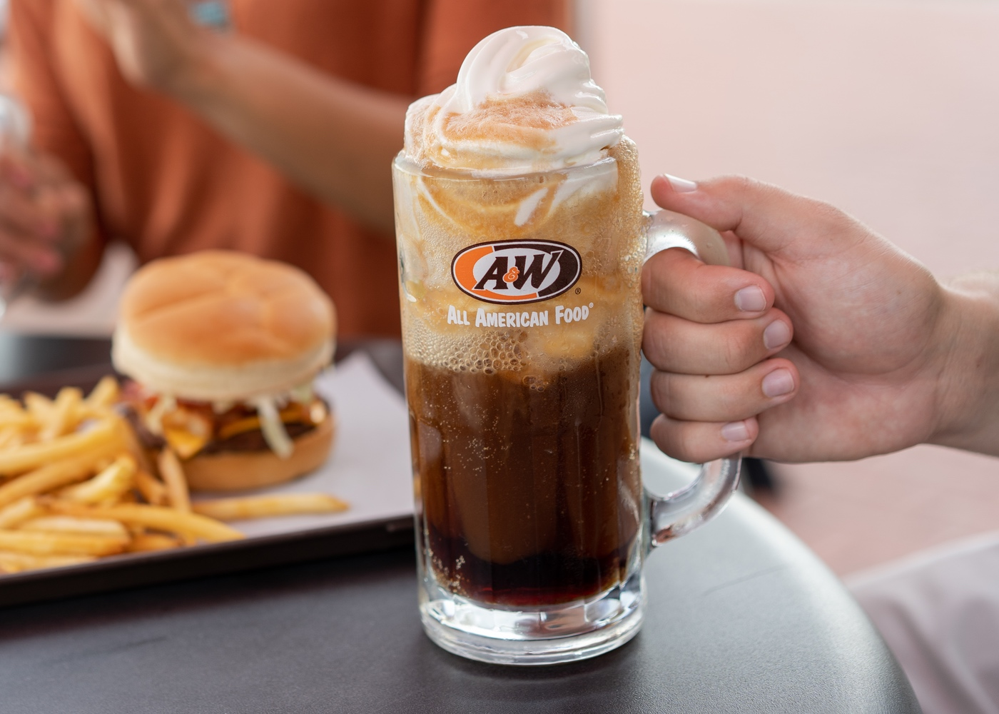 Person holding Root Beer Float in A&W Mug