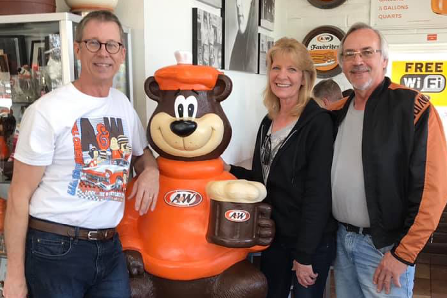 Carol & Mark pose beside a Rooty the Great Root Bear statue with A&W Lodi, CA Owner Pete