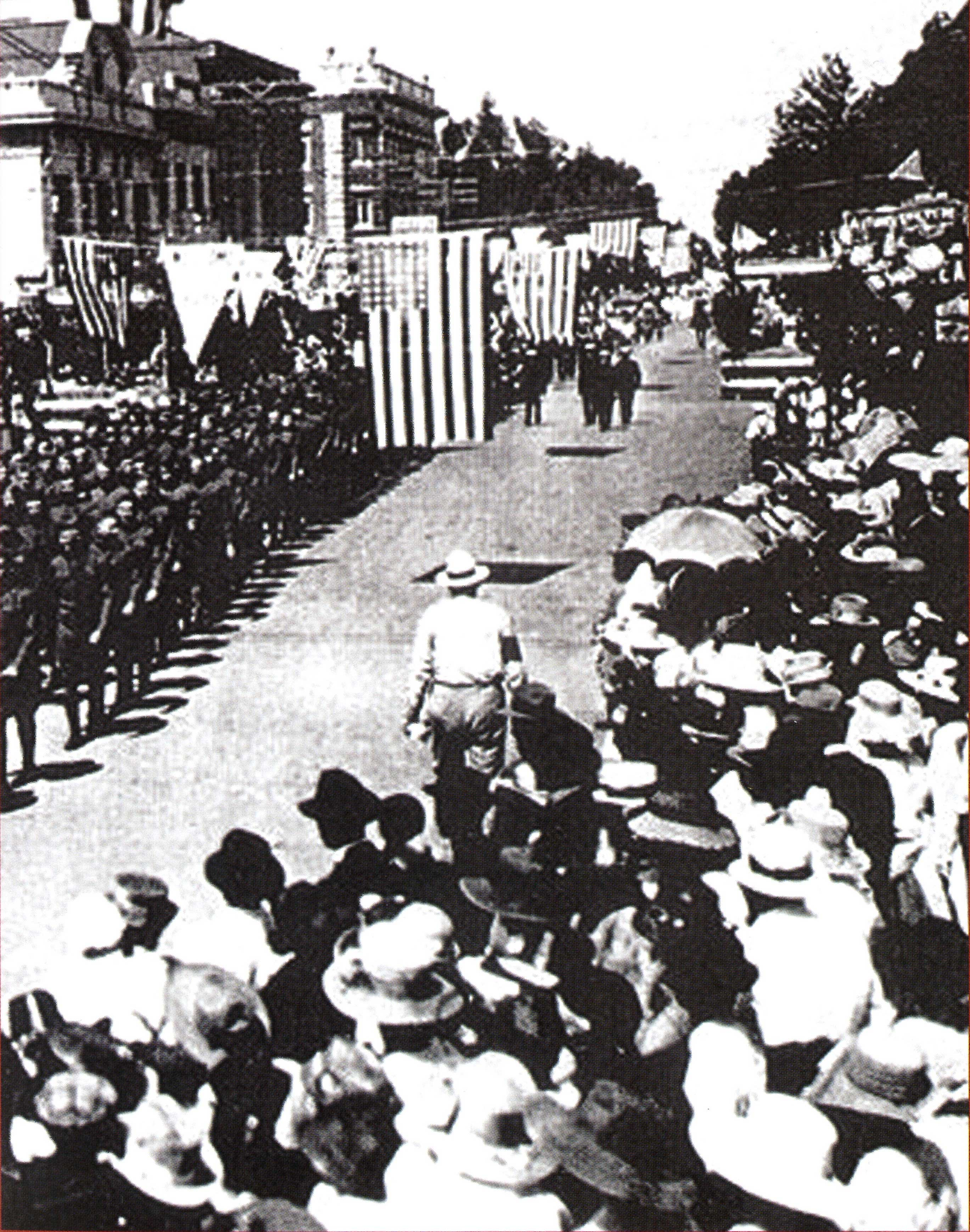 June 21, 1919 military parade, Lodi, Calif., with first A&W stand in upper right)