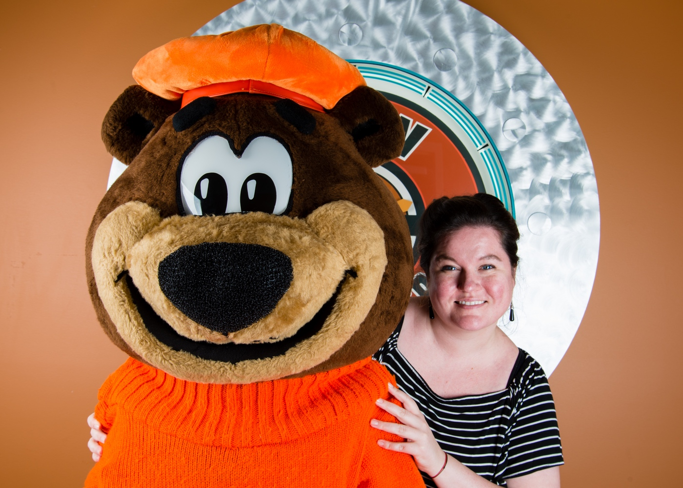 Photo of Liz Bazner posing with Rooty the Great Root Bear