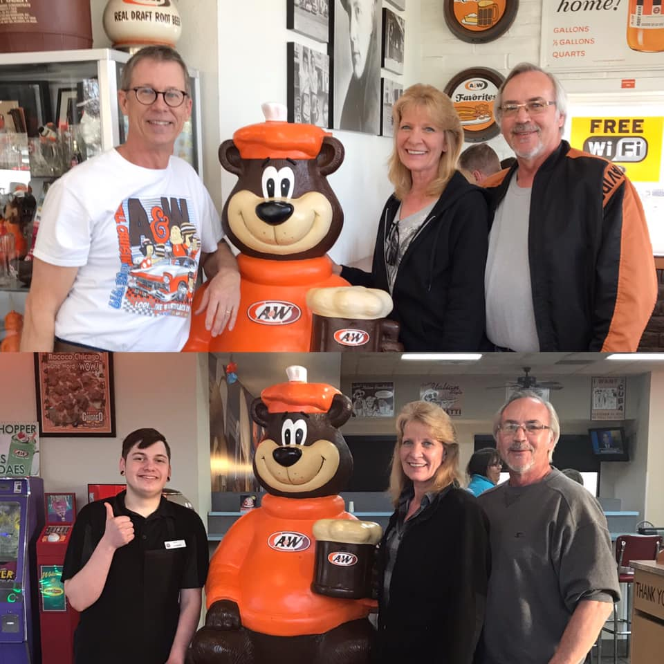 Top Photo: Carol and Mark pose in front of Rooty the Great Root Bear statue with A&W Lodi, CA owner Pete Knight; Bottom photo: Carol and Mark post in front of a Rooty the Great Root Bear statue with team members at the Lodi, WI A&W.