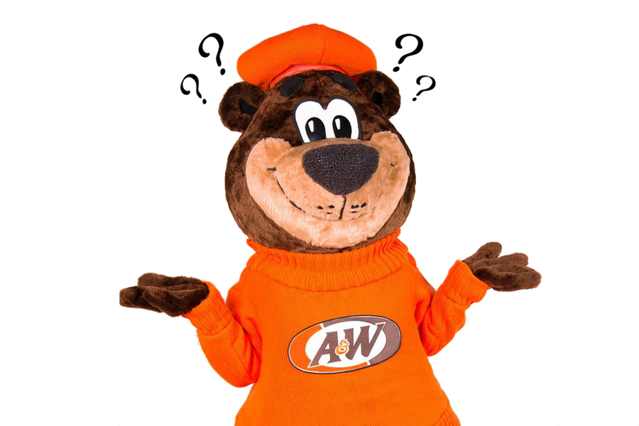 Rooty the Great Root Bear holding hands out with question marks above his head.
