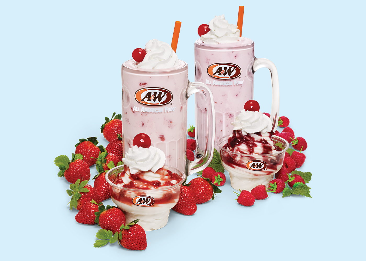 The background is light blue. Photo of a Strawberry Shake and Strawberry Sundae are on the left side of the image surrounded by real strawberries. Photo of a Raspberry Shake and Raspberry Sundae are on the right side of the image surrounded by real raspberries.
