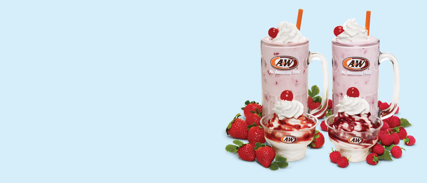Photo of a Strawberry Shake and Strawberry Sundae are on the left side of the image surrounded by real strawberries. Photo of a Raspberry Shake and Raspberry Sundae are on the right side of the image surrounded by real raspberries.
