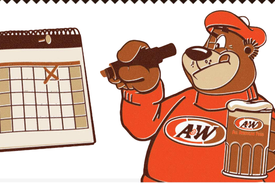 Rooty the Great Root Bear holding mug of A&W Root Beer in one hand and a marker in the other. Rooty is marking dates on a calendar.