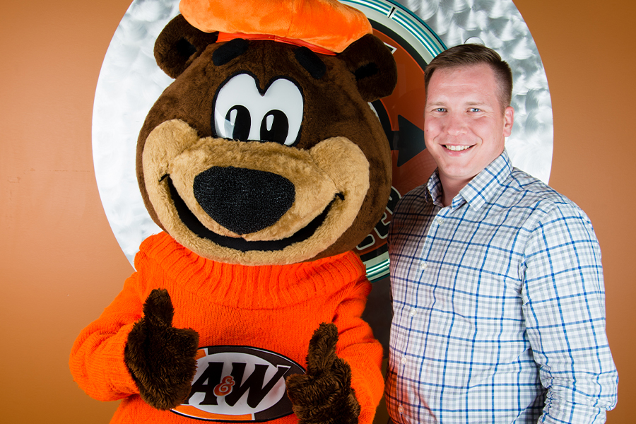 Photo of Silas Gray and Rooty the Great Root Bear