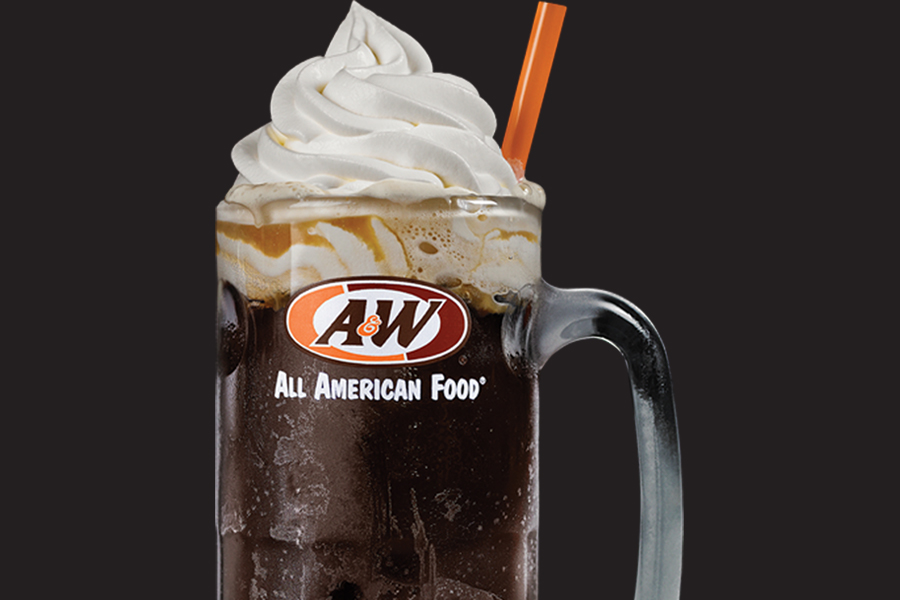 Photo of a Root Beer Float in a glass A&W mug on a black background.