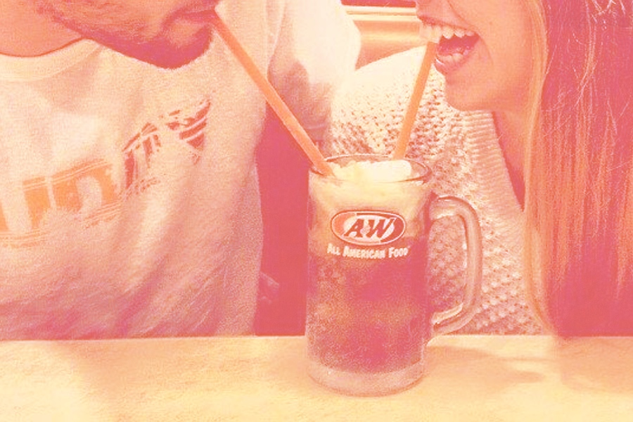Boy and girl drinking from a Root Beer Float with two straws
