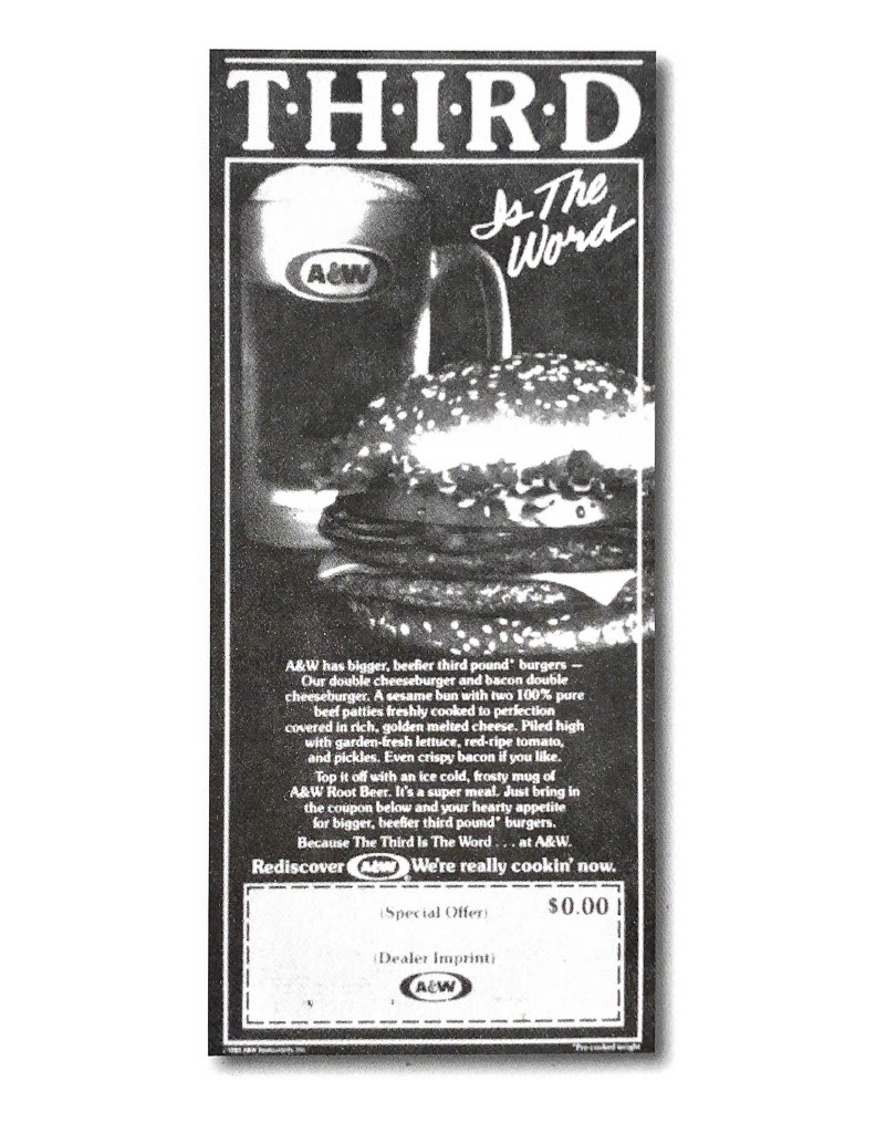 "Vintage black and white ad from the 1980s. Text at the top of the ad reads ""Third is the Word"" with photo of a Burger and mug of A&W Root Beer below the text."