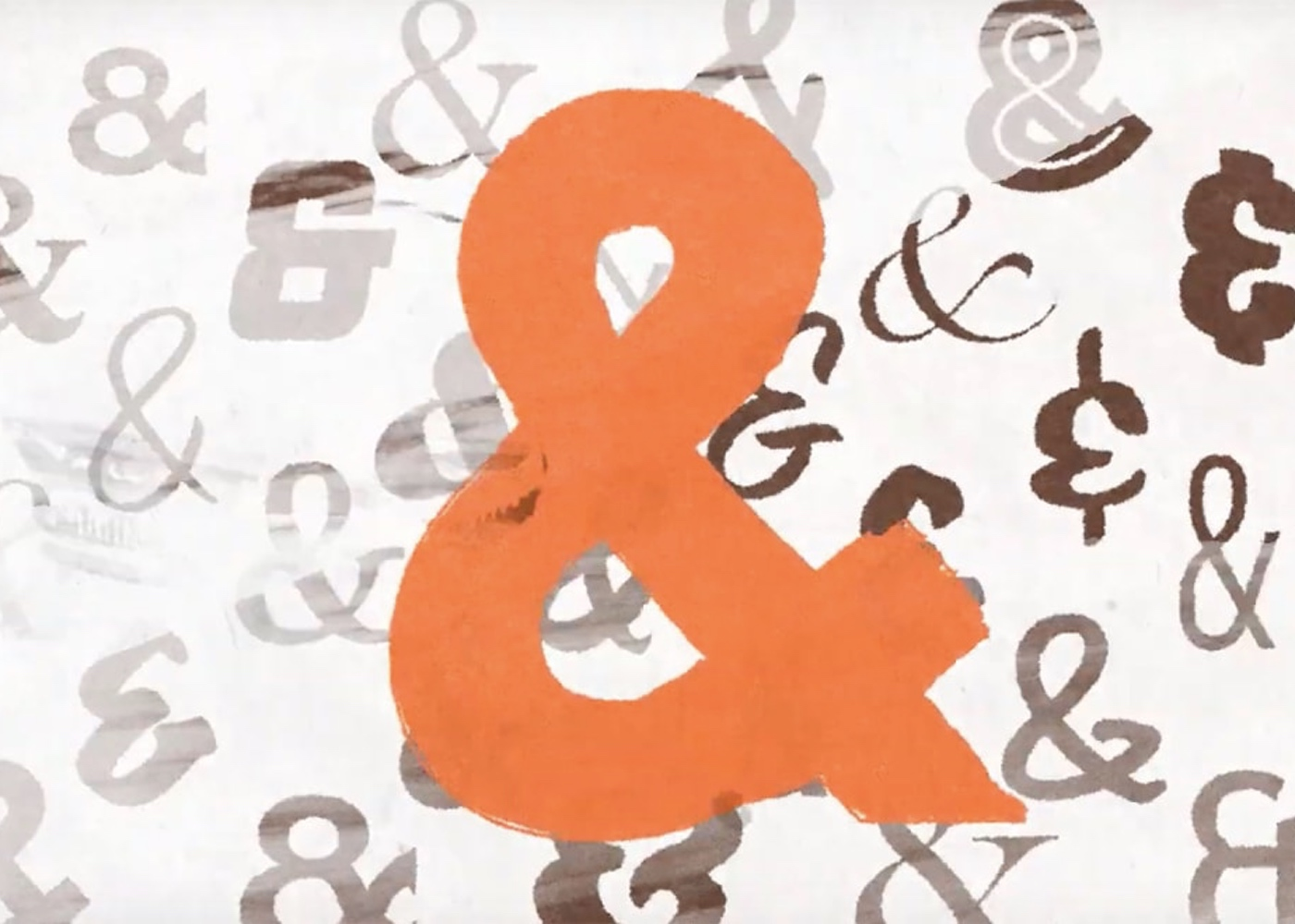 large orange ampersand with brown ampersands in the background