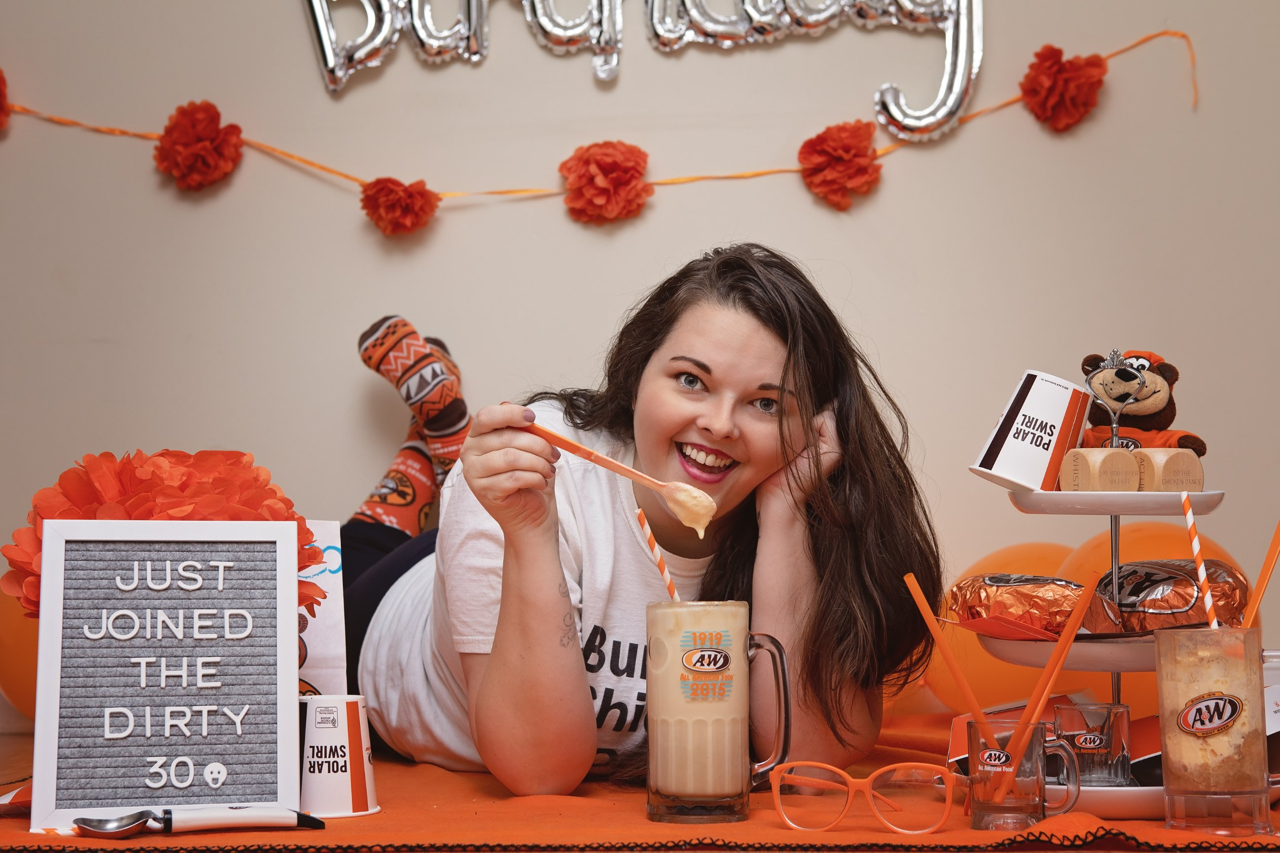Briana with root beer float in A&W mug